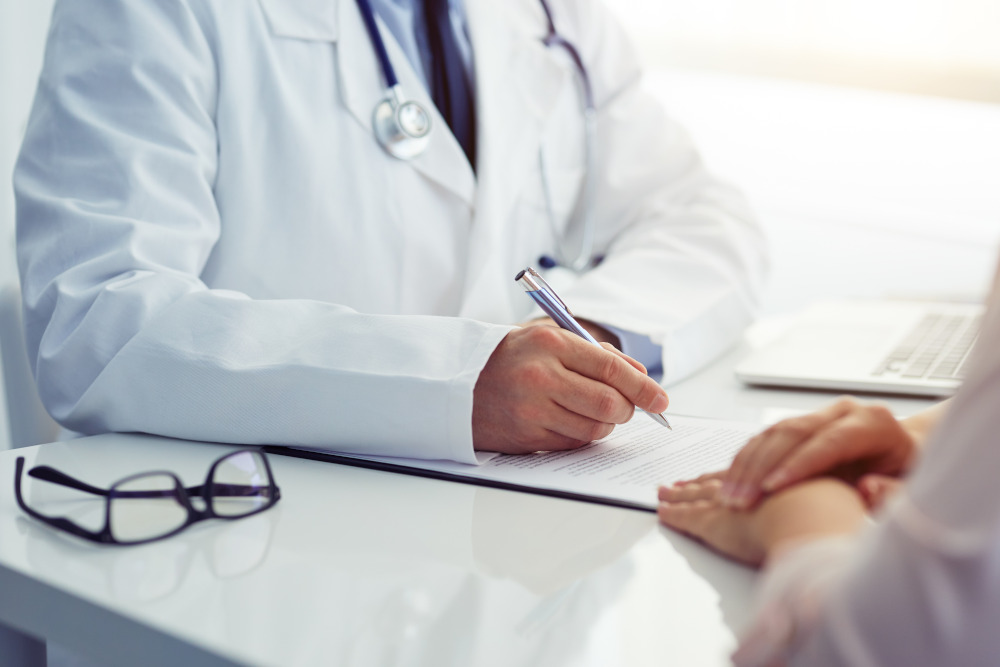 Doctor in office setting talking to a patient