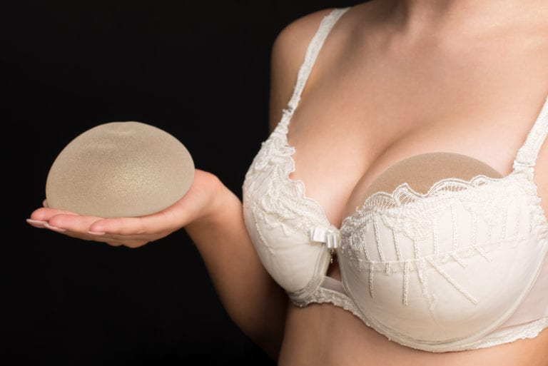 lady holding allergan breast implant